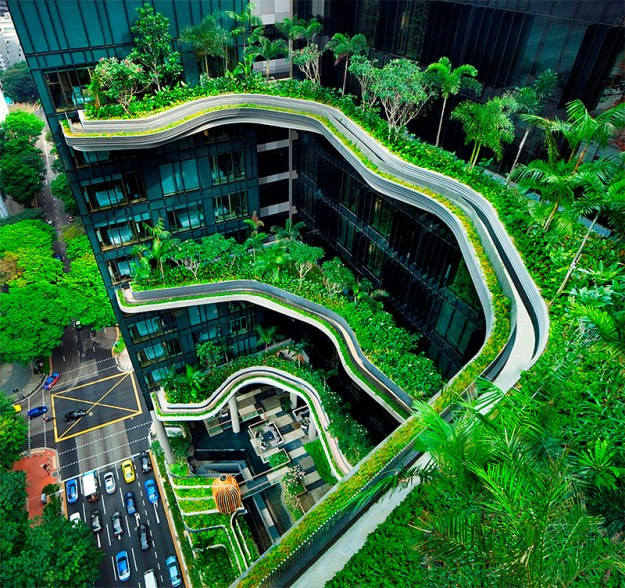Singapore's Parkroyal on Pickering hotel displays its green credentials in the form of an artfully tiered façade dotted with tropical ferns and creeping vines. Along with an efficient cooling system, its green perks include rainwater harvesting, lighting sensors, and high-performance window glass and hot water pumps. (Photo credit: Patrick Bingham Hall)